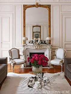 Can't go past an upholstered chair and matching walls...Colorful and Romantic Paris Apartment | Traditional Home