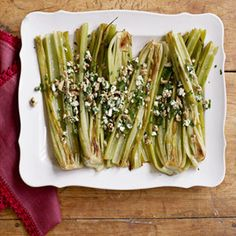 A unique approach to preparing celery, this recipe roasts the crisp vegetable that is so often eaten raw or added to soups and stocks, then adds creamy blue cheese and crunchy walnuts. Recipe: Roasted Celery and Blue Cheese Blue Cheese Recipes, Celery Recipes, Vegetable Recipes, Celery Ideas, Vegetarian Dinners, Vegetarian Recipes, Cooking Recipes, Vitamix Recipes, Cooking Tips