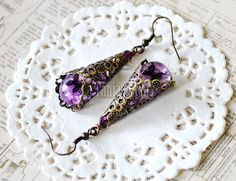 Purple Victorian Earrings – Flower Resin Earrings, Dried Flower Jewelry, Real Flower Earrings, Boho Jewelry, Filigree Earrings, Teardrop  This beautiful Victorian inspired earrings are made by me from scratch. I used high quality resin that I hand colored and placed some purple dried flowers and butterfly films in it. I make all my jewelry with handmade silicone molds in which I pour the resin, Then the teardrop resin earrings ware neatly sanded and polished. The purple teardrop resins are…