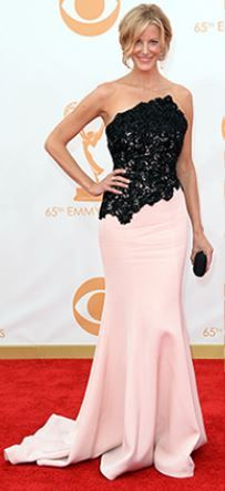 I love the combination of black and pink. Ramona Kaveza designed this stunning blend of black lace and fitted pink skirt for the red carpet Emmy's. What a statement this would make at a wedding, an evening party or even as mother of the bride!