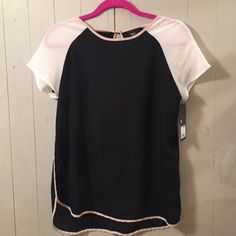 Black & White Blouse with Pink Mossimo This is a small black and white blouse with pink trim around the edges! It is new with tags! Wear it to work and then add a fun necklace for a night on the town! Mossimo Supply Co. Tops Blouses