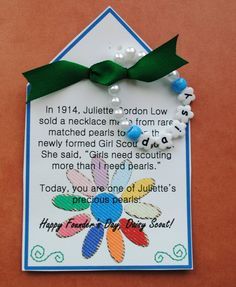 Girl Scout Daisy Founders Day ... given at Founders Day.  Wear pearls as bracelet or hang on backpack.