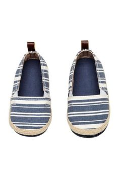 Cotton canvas espadrilles with a decorative braided trim around the soles, elastic gores in the sides and a loop at the back. Cotton linings and insoles and