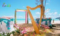 enchanted harp waiting to be played on the beach at a wedding