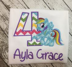 Colorful rainbow pony birthday number shirt!  So cute!!  Perfect for a little girls birthday.    www.emmylouchildrens.etsy.com
