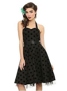 "<p>Black swing dress with a black flocked polak dot pattern, halter strap, tulle underlay and satin waistband tie. Side zipper closure.</p><ul><li>35"" long from center front</li><li>97% cotton; 3% elastic</li><li>Wash cold; line dry</li><li>Imported</li></ul>"