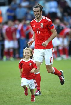 f260a115207 #EURO2016 Gareth Bale of Wales celebrates the victory with his daughter  Alba Bale on the