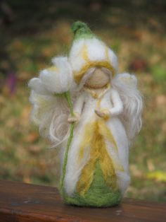 Flower Fairy narcissus needle felted doll via Etsy.