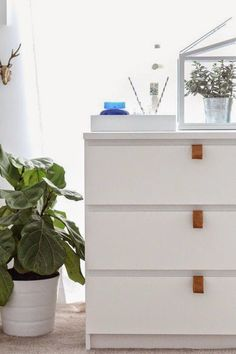Just because sometimes it's super annoying to have to pull MALM drawers out from the top (also, don't EVER do this with wet nails) why not add some leather straps to make life a little easier?  Get the tutorial at Sugar & Cloth »   - HouseBeautiful.com