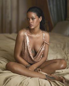 Sitting on a bed, Rihanna wears a sequin embellished dress from Saint Laurent by Hedi Slimane.  Vogue April 2016