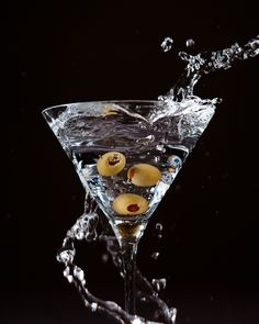The Perfect Martini   Grey goose, vermouth over ice shake and serve with 3 olives...oh yeah