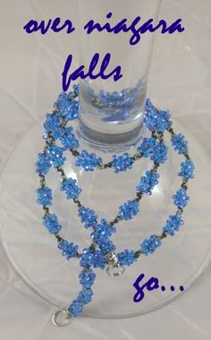 OVER NIAGARA FALLS: $19.99.. light blue, clear glass beads w/ a black twist of twine. INTERCHANGEABLE JEWELRY CHAINS that becomes a: lanyard, necklace, choker, belt, or eyeglass chain. Includes gift packs with all connector pieces needed.