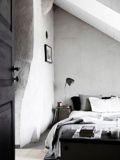 Monochrome grey/black/white bedroom in Stockholm.