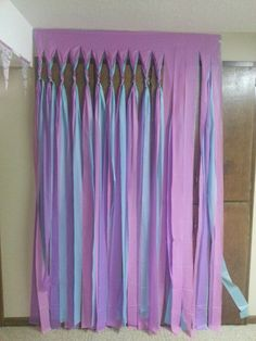 Took $1.00 table cloths, cut slits and braided the tops to create fun party wall cover ups for my daughters birthday party at home. Easy way to create a light curtain