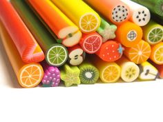 Polymer clay canes...I've made jewelry with cane slices before. Make sure you have your tweezers handy. (20 Fruit Canes Mix, All Fruit Polymer Canes by YumFoodJewelry on etsy)