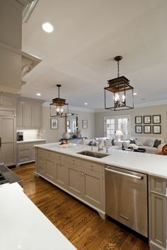 I love the lenght&width of the island!!! I would have the remainder of the right side for additional cabinetry and a walk in pantry (NOT a living room type space!!!)