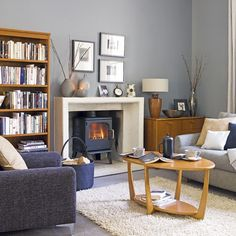 Looking for cosy living room design ideas? Take a look at this bold living room from Homes & Gardens for inspiration. For more living room ideas, such as how to decorate with black paint, visit our living room galleries Grey Walls Living Room, My Living Room, Living Room Furniture, Living Room Decor, Living Spaces, Brown Furniture, Wooden Furniture, Blue Grey Walls, Grey Wall Color
