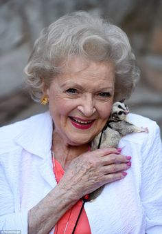 Furry friends: Betty White got to cuddle up with some of the creatures at LA Zoo on Saturday for the 45th Annual Beastly Ball. Here she is pictured with a tiny Sugar Glider