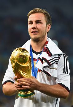 Mario Goetze of Germany celebrates with the World Cup trophy after defeating Argentina 1-0 in extra time during the 2014 FIFA World Cup Brazil Final match between Germany and Argentina at Maracana on July 13, 2014 in Rio de Janeiro, Brazil. - Google Search