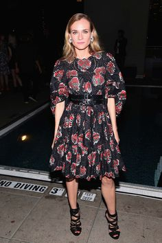 Diane Kruger in Alexander McQueen dress and belt, Chopard jewelry and Giuseppe Zanotti shoes.