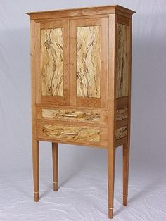 Vermont Craftsman Joe Breznick's Handmade Tall Chest of Cherry and Spalted Maple. Makes For a Great Cabinet In Any Sort of Environment. Available from Breznick Woodworking. Simply Gorgeous!