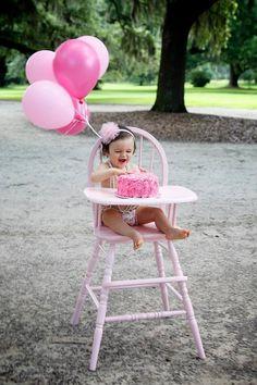 Baby girl smash cake photography session. Outdoor smash cake session. Michelle Marie photography in Charleston, SC. Pink smash cake. Vintage high chair. High chair smash cake session. First birthday.