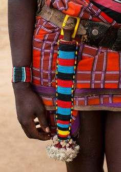 Beadwork on Bana man in Ethiopia by Eric Lafforgue.
