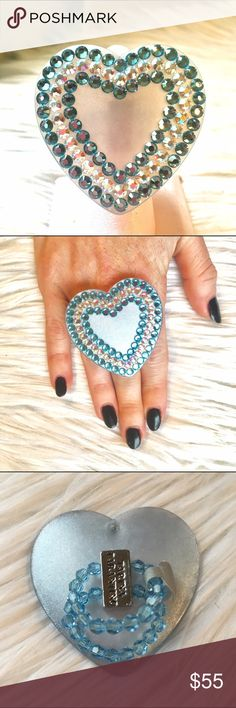Large Swarovski crystal heart ring Tarina Taranto large blue heart ring. Blue and AB crystals lining the heart. The crystals shine so beautifully! Ring is stretchy to fit most sizes Tarina Tarantino Jewelry Rings