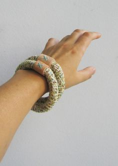 Handmade. Crochet bangle with squirt dye cotton yarn and merino wool. Decorated with leather   Colors: turquoise, sand, mint, yellow, rust, camel,