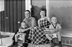 Portrait of American astronaut Virgil 'Gus' Grissom (1926 - 1967) as he poses with his wife Betty and their sons, Scott and Mark, August 1959.