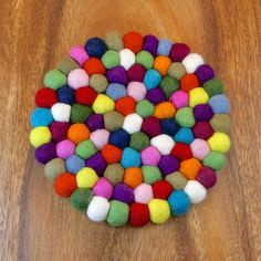 Fair Trade Felt Ball Trivet - Nepal — This round multicolored felt ball trivet will hold your hot pots and pans in style!