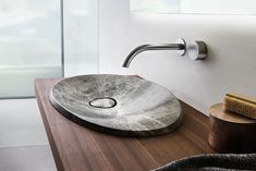 This modern natural stone bathroom sink named Caldera, was inspired by the shape of volcanic craters. Stone Bathroom Sink, Natural Stone Bathroom, Bathroom Sink Design, Home Depot Bathroom, Wood Sink, Modern Bathroom Sink, Ideal Bathrooms, Glass Sink, Wooden Bathroom