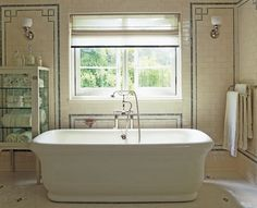 Suzie: Roman and Williams - Wall design.  Spa-like master bathroom with sparkling white soaking tub, white ...