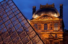 The Louvre Museum with Glass Pyramid in Paris, France
