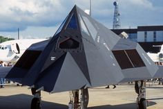 USAF Stealth Fighter from the based at Holloman AFB in the static park at Air Fete 97 at RAF Mildenhall. Stealth Aircraft, Fixed Wing Aircraft, Fighter Aircraft, Fighter Jets, Military Jets, Military Aircraft, Military Pictures, Modern Warfare, Military History