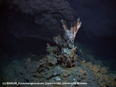 Black smoker spitting out sulfide minerals.