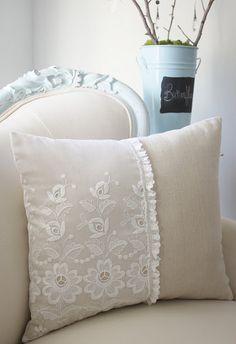 vintage lace on plain linen pillow