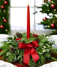 Christmas Centerpieces with Candles | Evergreen centerpiece with red candle.
