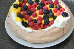 Cocoa Pavlova with Cream, Passionfruit Curd and Red Fruits