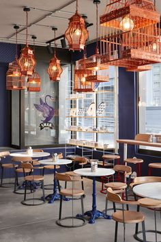 Haldane Martin have recently completed a new café for Cape Town: a traditional French crêperie called Swan Café. #CafeInterior #InteriorDesign #CopperLighting #BirdcageLighting