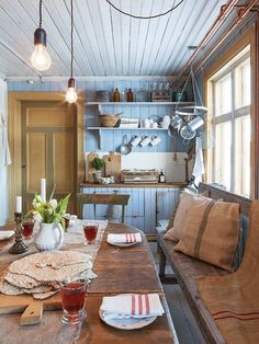 Rustic country kitchen with painted matchboarding.
