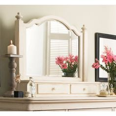 Complete the look of your home with this Paula Deen Home The Lady's Storage Mirror. Made of cherry veneers and solid hardwoods, this mirror has a rich linen coloring that will complement your home dec