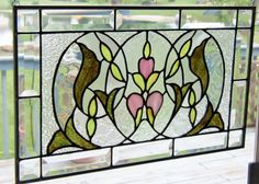Hang stained glass window on kitchen window (overlay)