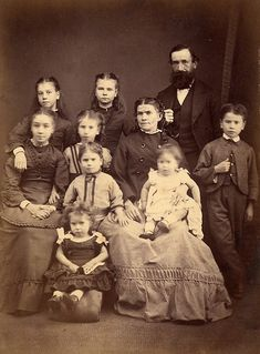 Inspiration for The Miles family in 1875--Taming Petra. Back row, l-r: Carrie (10), Sarah (12), Augustus (deceased). Middle row, l-r: Addie (14), Bess (7), Agnes (40), Mickey (9). Third row, l-r: Ernie (5), Rose (3). Floor: Lily (3).
