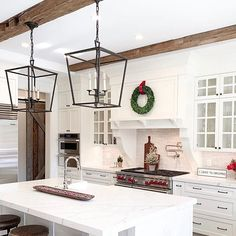 A clean modern kitchen with rustic hand hewn beam accents Kitchen Redo, Kitchen Remodel, Kitchen Design, Hand Hewn Beams, Wood Beams, Modern Rustic Decor, Kitchen Countertops, Kitchen Cabinets, Home Kitchens