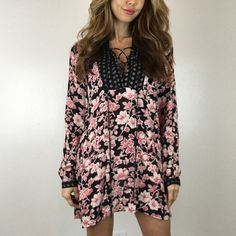 """Floral Boho Tunic S M L A gorgeous and versatile tunic that can be worn as a top, dress or beach cover up. Has a rich dark floral print with cross cross detailing in the front that makes this piece stand out. Think Tory Burch or Free People at the fraction of the price. Size M measures 23"""" across the chest 32"""" in length. 100% Rayon.  For size reference I am wearing Size S 5'3""""-105lbs -Sz 0/2 * Please do not purchase this listing- I will provide a new listing for you- Thank you! * Boutique…"""