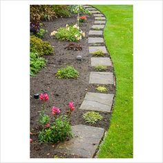 garden border with attractive edging of stepping stones with low growing plants between...