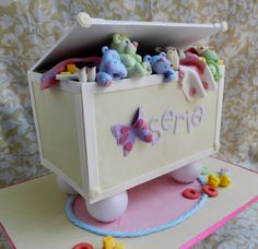 Toy box baby shower cake! - I freakin loved making this one. The critters are made from fondant and tylose :)
