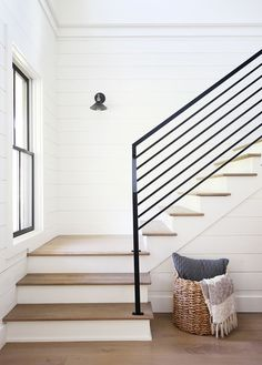 Modern Farmhouse Design Tips. These interior design tips and tricks will help you add elements of the modern farmhouse design trend in a way that adds beautiful details to your house plans. Choosing details like paint colors, textures, materials Modern Farmhouse Interiors, Modern Farmhouse Design, Farmhouse Decor, Farmhouse Style, Farmhouse Stairs, Modern Staircase, Staircase Design, Modern Railings For Stairs, Black Stair Railing