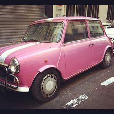 This beautiful girl has been parked in the same spot for the entire time I've lived in France. Sad that no one ever takes her for a spin; I'd love to before Dec 10 if her owner sees this. Want. Badly. #pink #paris #france #vintagemini #minicooper (at rue de Rameau) http://parlezvousloco.tumblr.com
